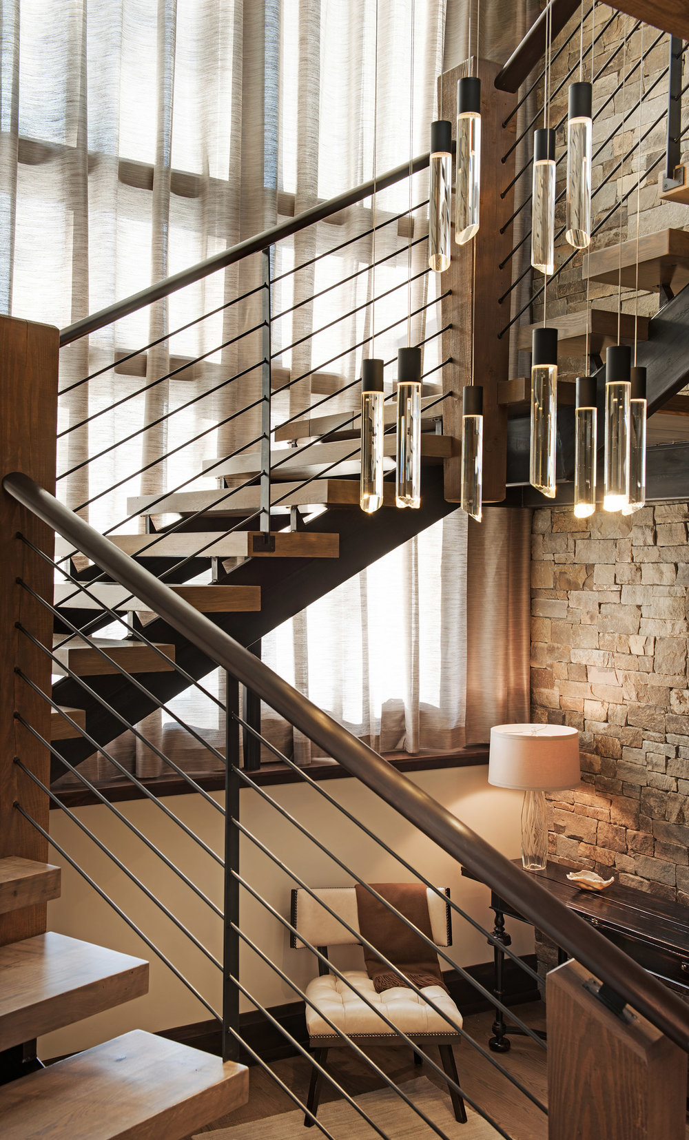 I love the modern staircase topped off with the gorgeous chandelier.
