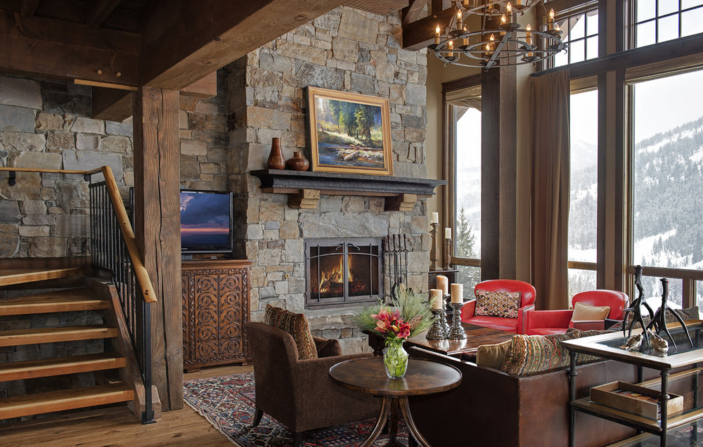 This cozy great room is sitting on the edge of the ski hill at  Yellowstone Club .  The pops of color really make the room come alive.  Architect -  Locati Architects