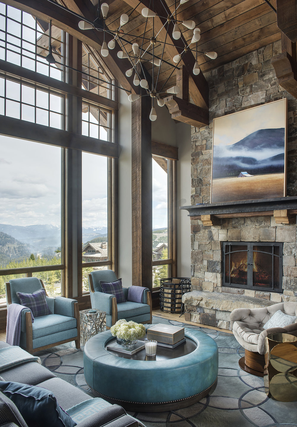 The vaulted ceilings, large open windows, and teal furnishings are what make me love this great room.   Teal is also my favorite color!  Architect -  Locati Architects , Interior Design -  Kelly Hohla Interiors