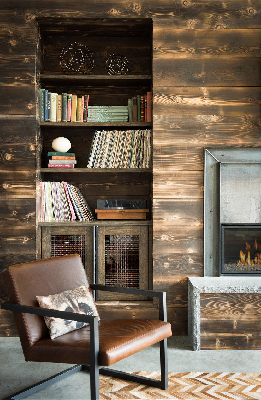 The charred cedar is what I love about this cozy corner.  This technique is a traditional japanese art called Shou Sugi Ban.  Architect -  Reid Smith Architects
