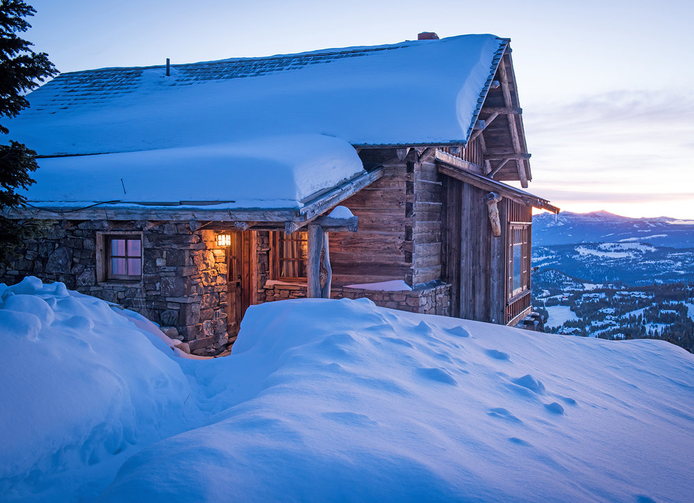 This quaint guest cabin sits high on Andesite Mountain in Yellowstone Club.  The views of the sunrise are incredible!  You almost feel like you are on the edge of the world!