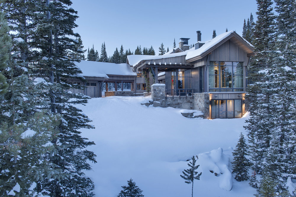 This gorgeouse Spanish Peaks Moutnain Club home was photographed early one very snowy morning.  It's such a cozy home tucked back on the mountain.  Architect - Centre Sky Architecture,  Builder - Big Sky Build