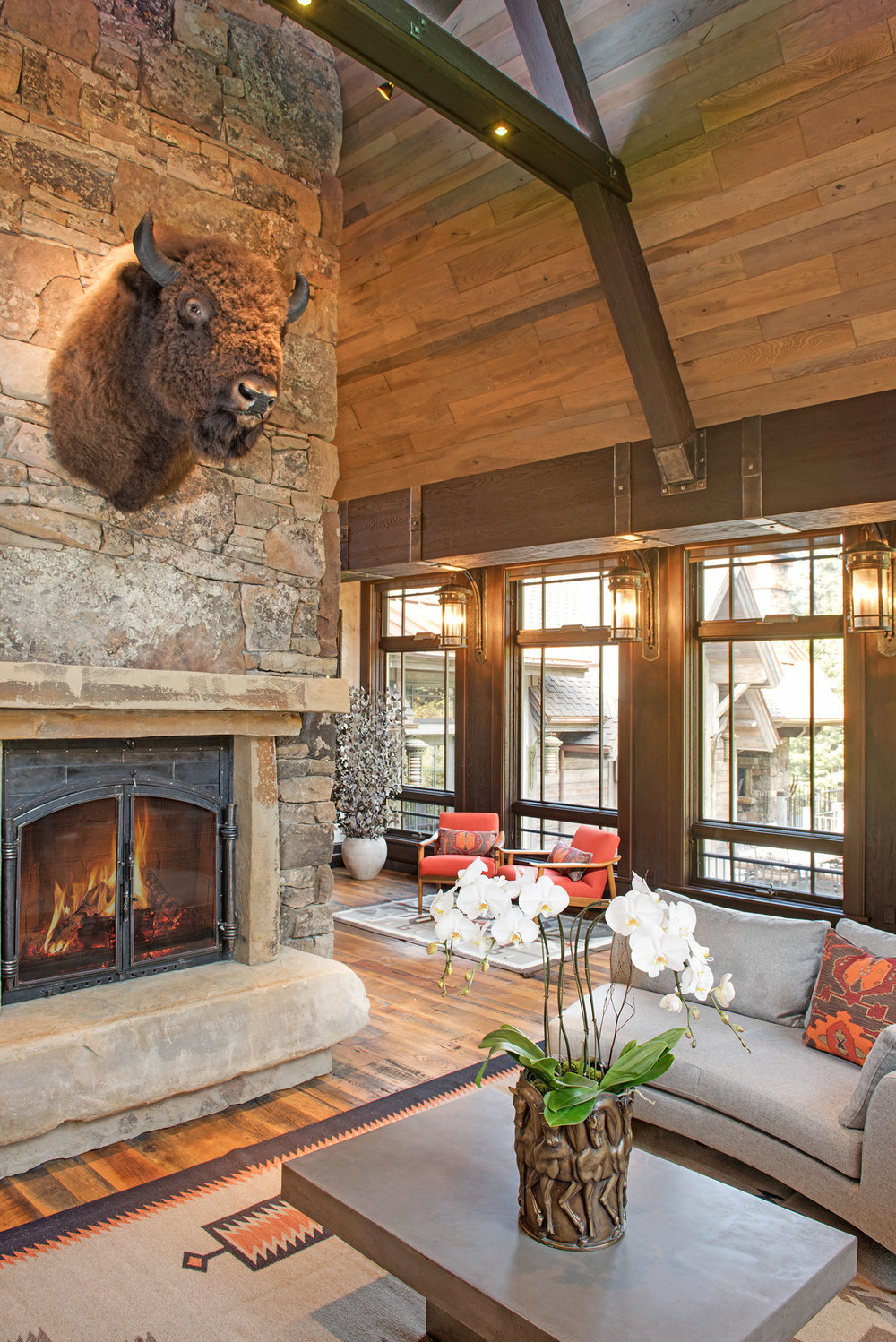 What is a Montana home without a large stone fireplace?  The architecture is amazing!  I love how you can sit by the fire while looking out the windows and enjoying the outdoors.