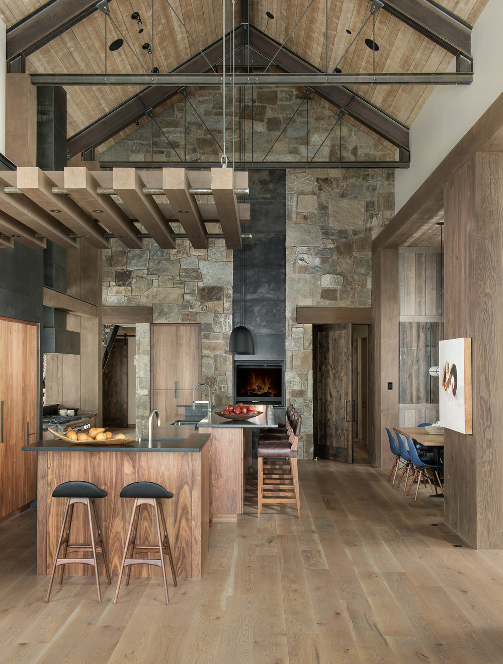 This kitchen... wow!  Who wouldn't enjoy having a real burning fire next to you while cooking?  Another great combination of stonework, wood, and steel.  Stunning!