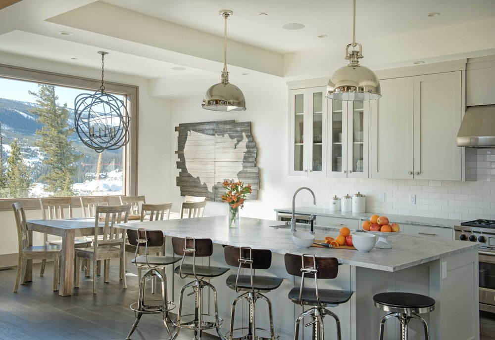 Natural light abounds in this open & airy kitchen.  Architecture Design by  Brechbuhler Architects