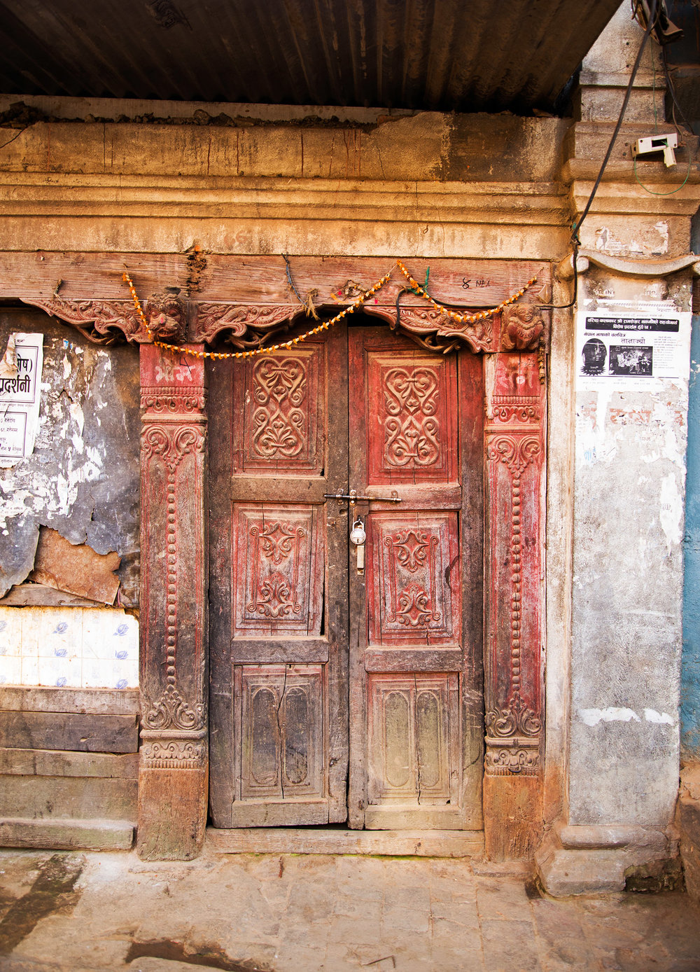 The reds and all the cracks in this door tell a story of history and life.  I am enthralled with the carvings throughout the door and frame.  Love!!
