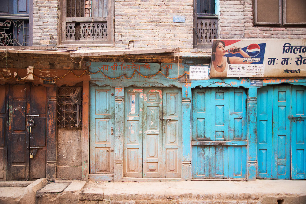 These doors line the busy streets of Kathmandu.  The colors and textures are so eye catching.