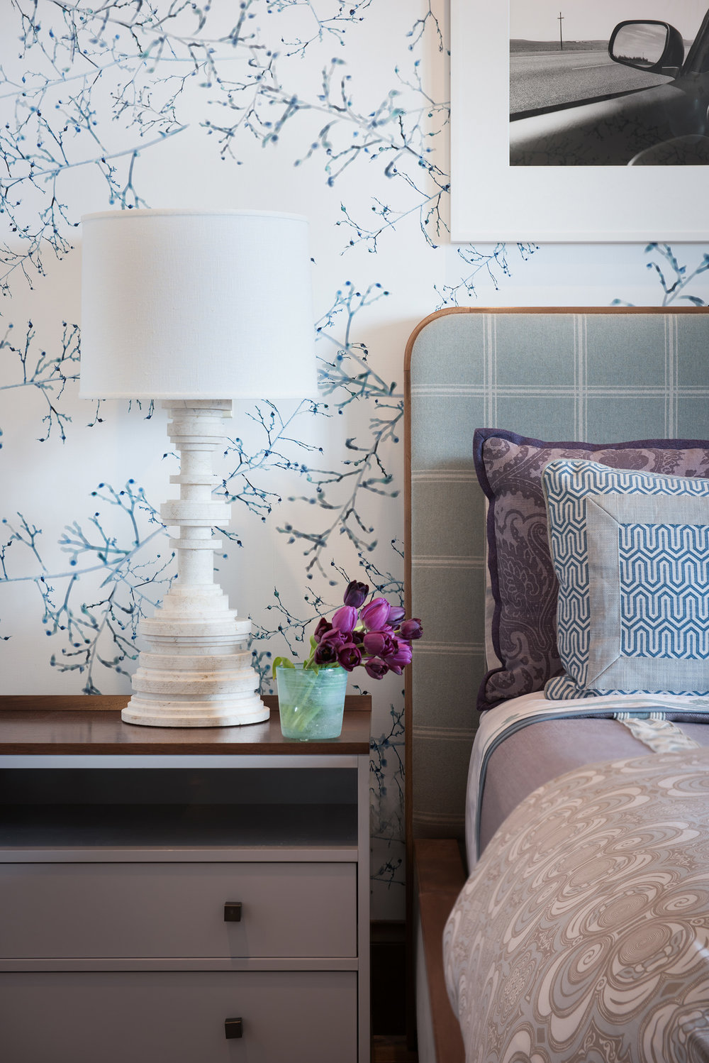 I love the use of purple on the bed, the wall, and the flowers!  Design by  Kelly Hohla Interiors .