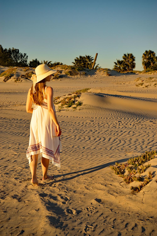Walking through the sand dunes in Coronado beach in San Diego, wearing O'Neill Dress