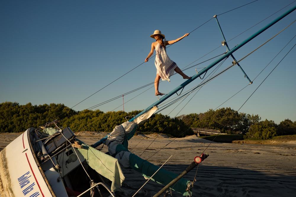 Climbing a ship wrecked sail boat on Coronado beach in San Diego.