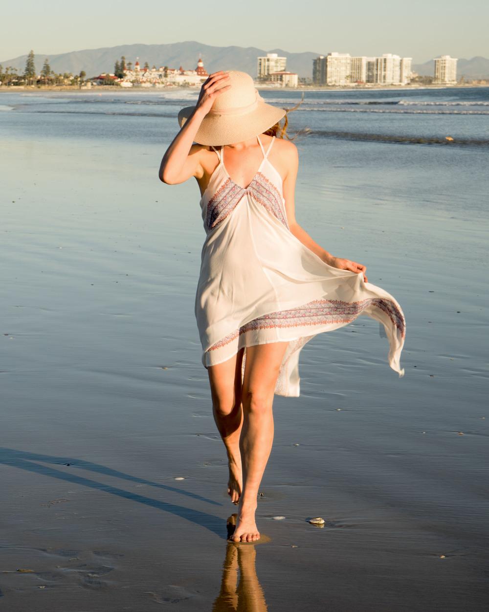 Walking on Breaker's Beach in Coronado, wearing O'Neill dress