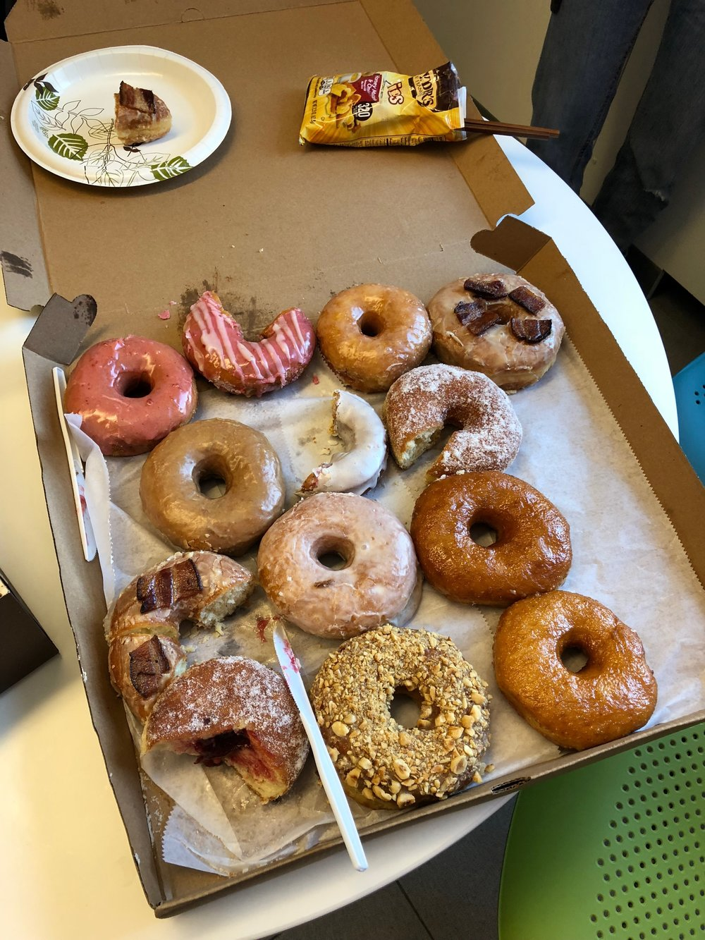 Donuts from the weekly farmer's market provided by the Principal Investigator himself. In the background, you can spy some of the pretzels the lab is addicted to, along with a set of chopsticks for mess-free eating.