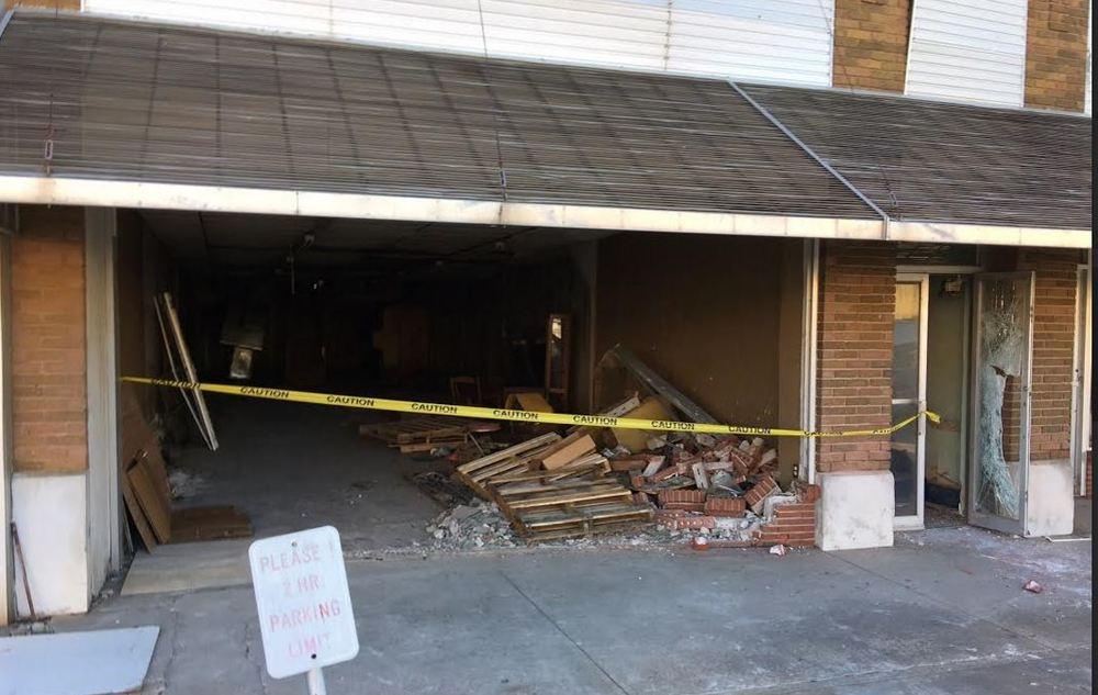 Demolition got a quick start with the store front. - Photo by RDMGtv