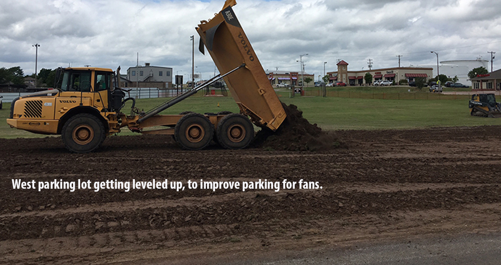 West parking lot gets the top soil for much needed leveling and drainage. Photo by RDMGtv