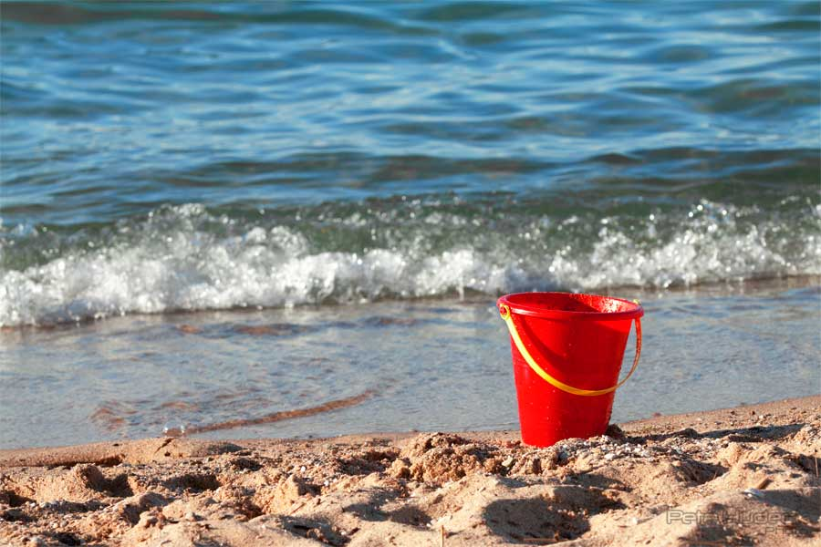 A red bucket on the shore of Grand Traverse Bay