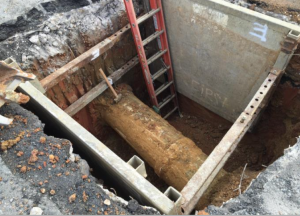 Preparing existing 36-inch SD main for placement of new SDMH 2 at Minnesota Avenue and Ridge Road.