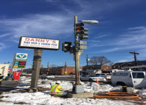 Transferring traffic signal pole to temporary foundation @ the NW corner of Minnesota Avenue & Ames Street