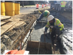 Concrete footing for curb & gutter sections adjacent to Low Impact Development (LID) structures