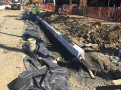 New granite curb installation on Minn. Ave., east side, between Ames St. & Blaine St.
