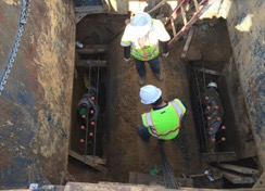Forming base for new SDMH 21 atop existing SD pipe on Minn. Ave. between Dix St. & Benning Rd.