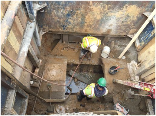Exposing existing 3 ft.-9 in. SD tunnel for SDMH 21 installation