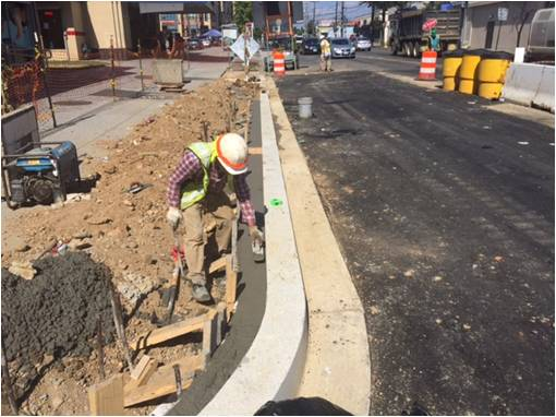 Finishing concrete for curbside LID footer, west side Minn Ave, b/t Dix St & Benning Rd
