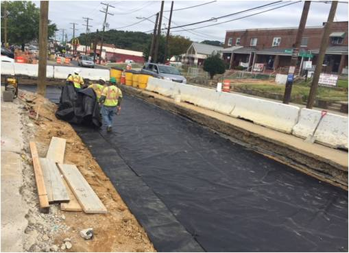 Geosynthetic fabric atop approved subgrade @ west side of Minn Ave, b/t Blaine St & Domino's Pizza