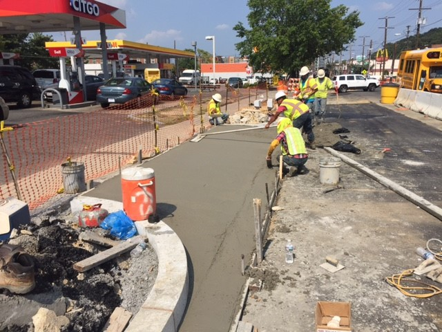 Finishing new concrete driveway apron @ Citgo Station