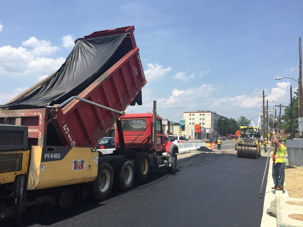 "Laying base 5"" base asphalt layer, east side of Minn Ave b/t Ames St & bridge"
