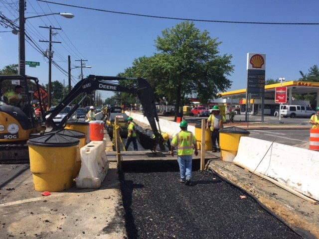 "Installation of 4"" drainable base course w/ temp pedestrian bridge @ Minn Ave & Clay Pl"