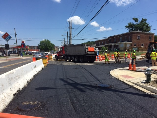 "Installation of 5"" roadway asphalt base course layer @ Minn Ave & Blaine St"