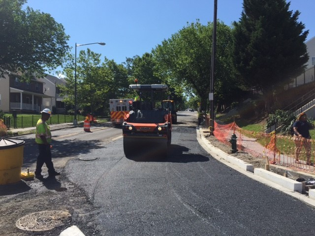 "Installation of 5"" roadway asphalt base course layer @ Ridge Rd"