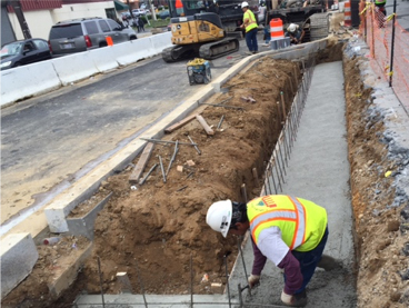 Finishing concrete for Bioretention LID 60 rear footer base, w. side of Minn Ave b/t Dix St & Benning Rd