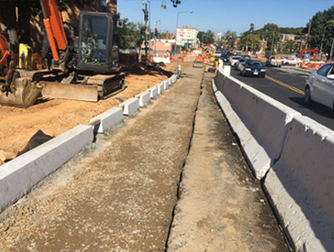 New granite curb-line, w. side Minn Ave b/t A St & Ridge Rd with openings for LIDs shown