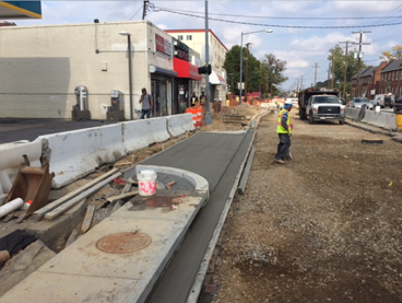 New driveway, granite, curb, gutter and stormdrain inlet IFO Valero Station, w. side Minn Ave @ Ames St