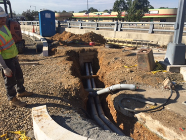 Installation of streetlight/traffic signal conduit b/t EMH 8 & 9 @ East Capitol St S. Service Rd