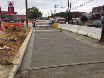 New bus stop pad, w. side Minn Ave & Blaine St   (IFO Dominos)