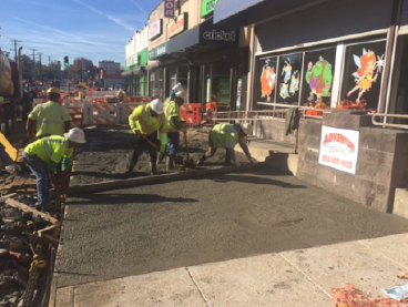 Initial concrete pour for exposed aggregate sidewalk, w. side b/t Dix St. & Benning Rd.