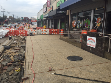 "Exposed aggregate sidewalk after ""scrubbing"" top layer, w. side b/t Dix St. & Benning Rd."