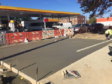 Initial concrete pour for exposed aggregate sidewalk, w. side i.f.o. Shell Station, b/t Blaine St. & Clay Pl.