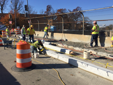 Installation of new granite curb for widened west side sidewalk atop bridge over East Capitol St.