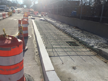New curb and rebar for proposed widened sidewalk across Minn. Ave. Bridge over E. Capitol St.