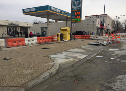 New exposed aggregate sidewalk in front of Valero Station