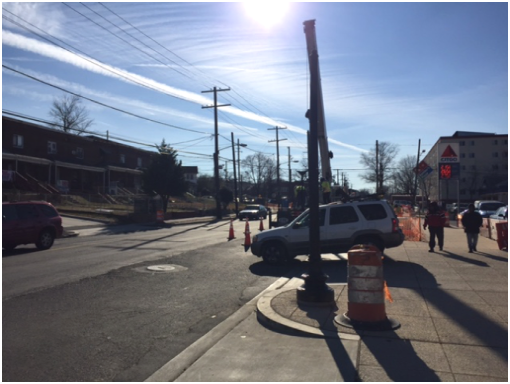 Erecting new 16 ft. high decorative streetlight pole b/t Citgo & Shell Stations