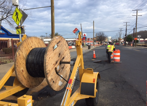 Pulling new traffic signal communication cable between new manholes @ Minn. Ave. & Blaine St.