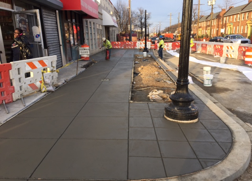 Forming new sidewalk, west side between Ames St. & Blaine St.