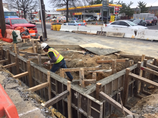 Finishing concrete for footer walls @ Bio-cell (LID) 47, e. side Minn. Ave. b/t Blaine St. & Clay Pl.