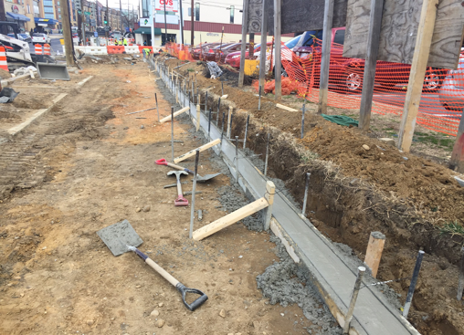 Finished foundation for new brick wall in front of McDonald's, e. side Minn. Ave., b/t Clay Pl. & Dix St.