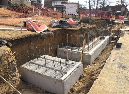 Retaining wall footings, east side b/t Blaine St. & Clay Pl.