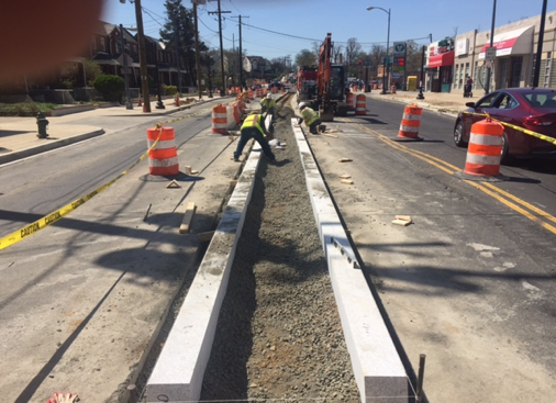 Installation of granite curb for new median b/t Ames St. & Blaine St.